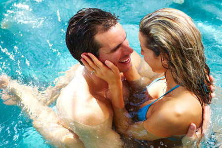 Photo for Young couple relaxing in hot tub. Summer vacation. - Royalty Free Image