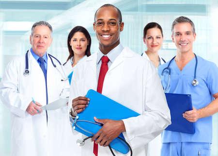 Foto de Medical physician doctor man and group of business people. - Imagen libre de derechos