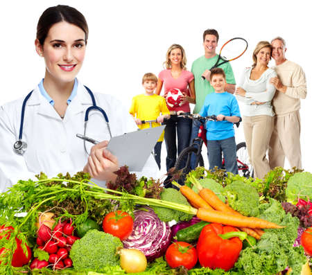 Photo for Doctor with vegetables and family. Healthy diet and nutrition. - Royalty Free Image