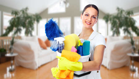 Photo pour Young smiling maid. House cleaning service concept. - image libre de droit