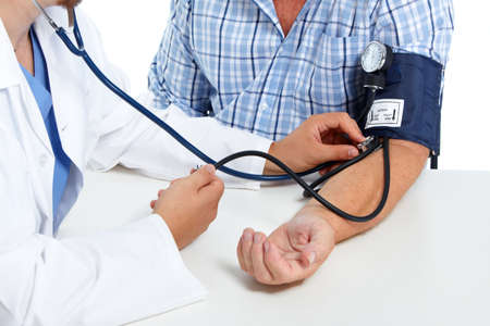 Foto de Doctor checking old man patient arterial blood pressure. Health care. - Imagen libre de derechos