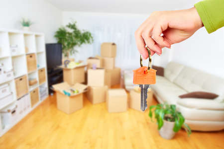 Photo pour Hand with house key. Real estate and moving background. - image libre de droit