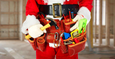 Photo pour Santa Worker with a tool belt construction background. - image libre de droit