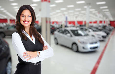 Photo pour Car dealer woman. Auto dealership and rental concept background. - image libre de droit