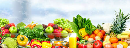 Photo pour Fresh Vegetables and fruits over green background. Healthy diet. - image libre de droit