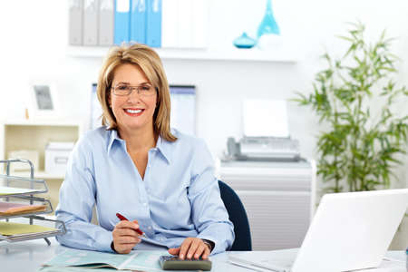 Photo pour Beautiful mature business woman working in modern office. - image libre de droit