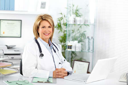 Photo for Mature doctor woman in a clinical office. Health care concept. - Royalty Free Image
