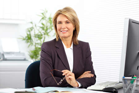 Photo pour Mature business woman working with computer in the office. - image libre de droit