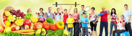 Foto de Group of fitness people with fruits and vegetables. Diet and weight loss banner. - Imagen libre de derechos