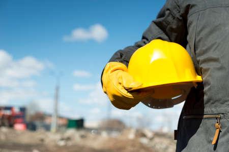 Foto de builder with yellow hardhat and gloves, selective focus - Imagen libre de derechos