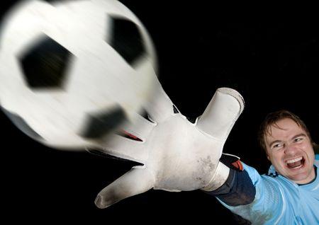 Goalkeeper defends ball
