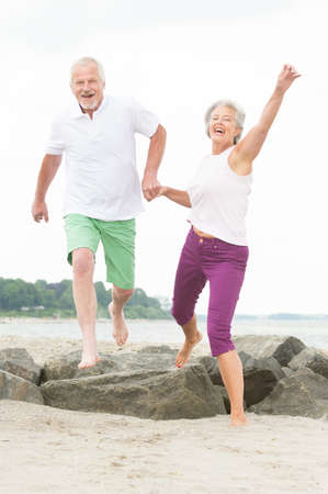 Photo for Active and sporty senior couple at the beach  - Royalty Free Image