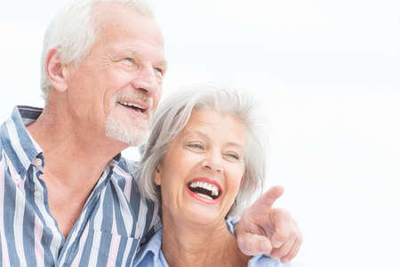 Photo pour Portrait from a happy senior couple in front of cloudy sky - image libre de droit
