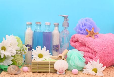 Bath and Spa Products With Sea Shells on Blue Background