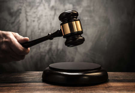 Foto de Judge's holding wooden hammer  - Imagen libre de derechos