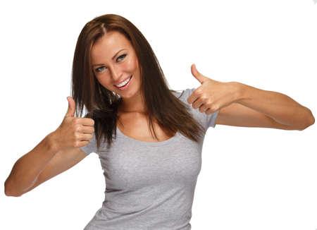 Photo pour Young positive brunette girl with long hair  showing thumbs up - image libre de droit