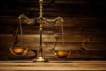Foto de Brass scales over wooden background  - Imagen libre de derechos