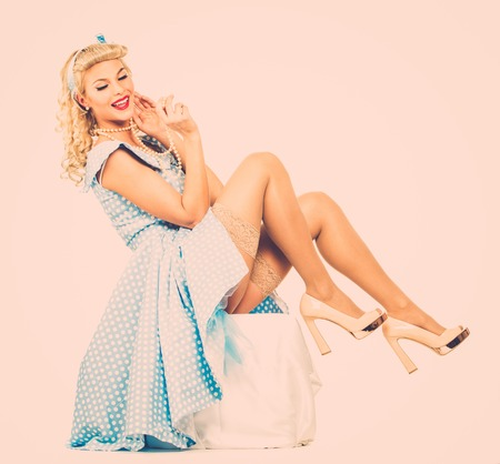 Photo pour Sexy coquette blond pin up style young woman in blue dress - image libre de droit
