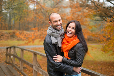 Foto de Happy middle-aged couple outdoors on beautiful autumn day - Imagen libre de derechos