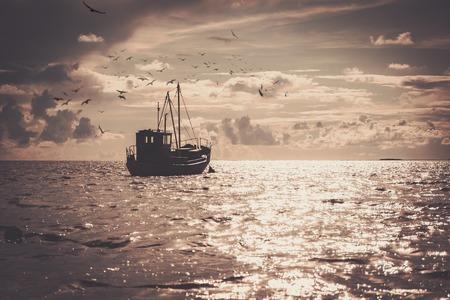 Photo pour Fisherman's boat in a sea - image libre de droit