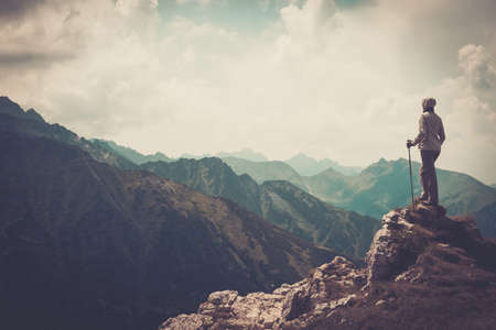 Foto de Woman hiker on a top of a mountain  - Imagen libre de derechos