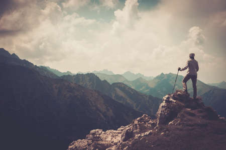 Photo pour Woman hiker on a top of a mountain  - image libre de droit