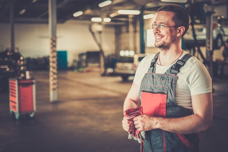 Photo for Serviceman in a car workshop - Royalty Free Image