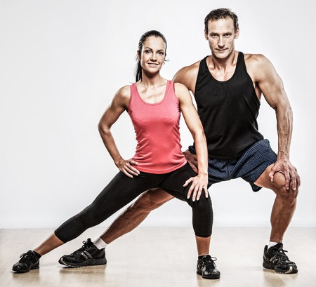 Foto per Athletic man and woman doing fitness exercise - Immagine Royalty Free