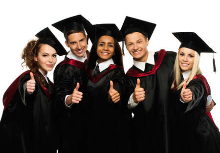 Photo pour Multi ethnic group of graduated young students isolated on white - image libre de droit
