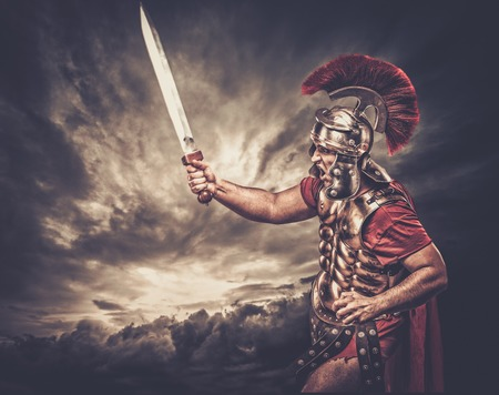 Photo for Legionary soldier against stormy sky - Royalty Free Image
