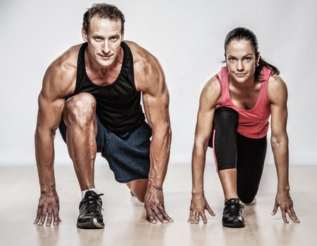 Photo pour Athletic man and woman doing fitness exercise - image libre de droit