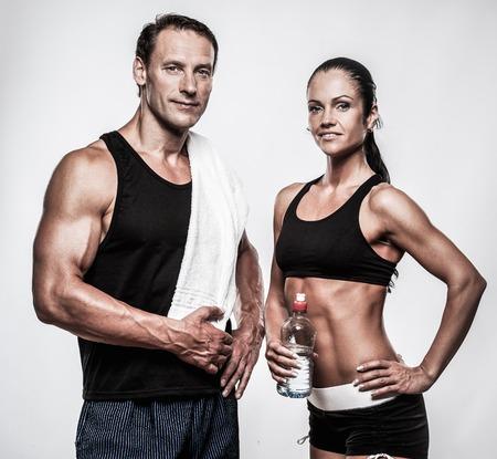 Photo pour Athletic couple after fitness exercise - image libre de droit