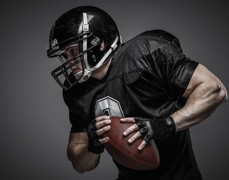 Foto de American football player with ball - Imagen libre de derechos