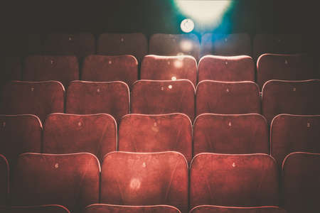 Photo for Empty comfortable red seats with numbers in cinema - Royalty Free Image