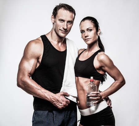 Photo pour Athletic couple after fitness exercise - image libre de droit
