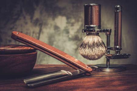Foto de Shaving accessories on a luxury wooden background - Imagen libre de derechos