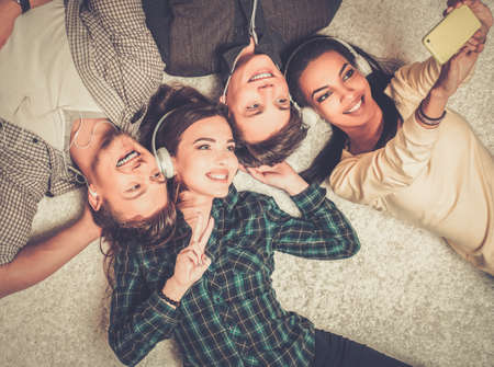 Photo for Happy multiracial friends taking selfie - Royalty Free Image