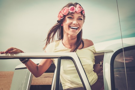 Photo pour Hippie girl in a van on a road trip - image libre de droit