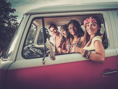 Photo pour Multi-ethnic hippie friends on a road trip - image libre de droit