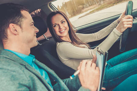 Photo for Driving instructor and woman student in examination car - Royalty Free Image