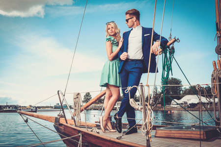 Photo for Stylish wealthy couple on a luxury yacht - Royalty Free Image