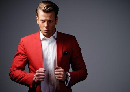 Photo pour Stylish man in red jacket - image libre de droit