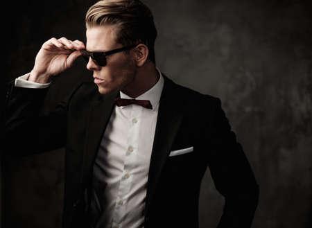 Photo pour Tough sharp dressed man in black suit - image libre de droit