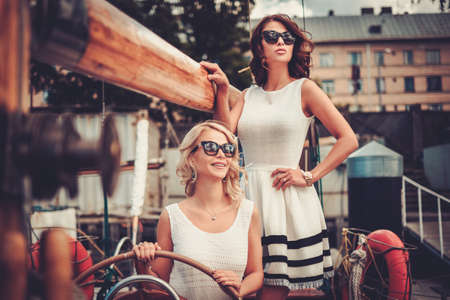 Photo pour Stylish wealthy women on a luxury yacht - image libre de droit