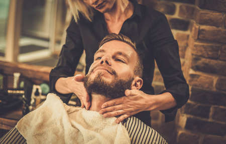 Photo for Hipster client visiting  barber shop - Royalty Free Image