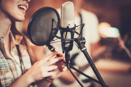 Photo for Woman singer in a recording studio - Royalty Free Image