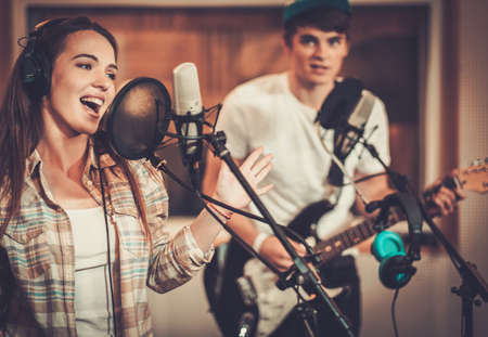 Photo for Music band performing in a recording studio - Royalty Free Image