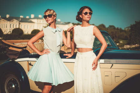 Photo for Two stylish ladies near classic convertible - Royalty Free Image