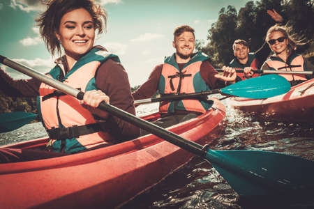 Photo for Group of happy people on a kayaks - Royalty Free Image