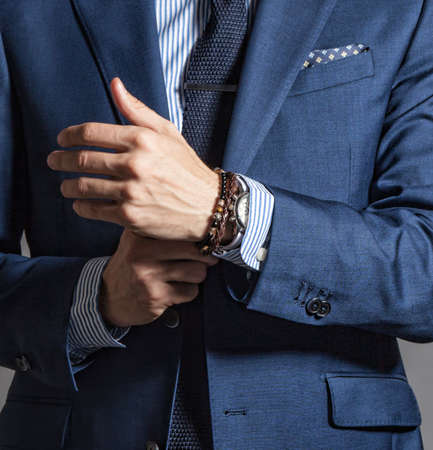 Foto de Suave modern man in casual style with bracelets on hand - Imagen libre de derechos